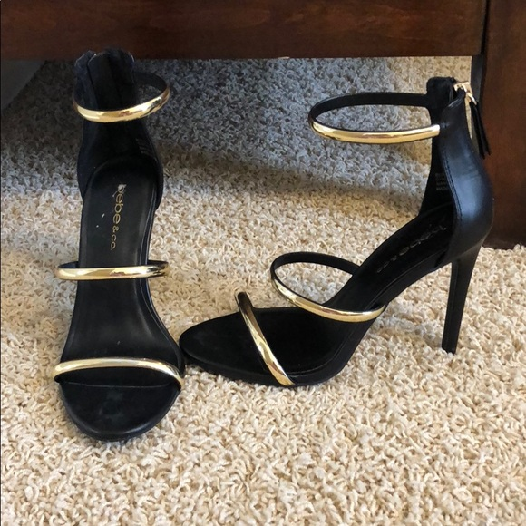 451dab53372 bebe Shoes - Bebe black and gold strappy heels size 6